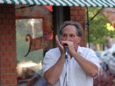 2012 Photo Gallery - Stephen Piazza playing the harmonica at the August 2nd First Friday in Chatham, NY