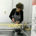 2013 Photo Gallery - Madeleine Delosh prepares something delicious.