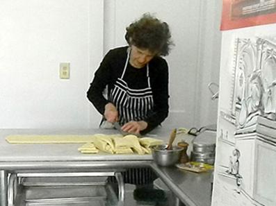 2013 Photo Gallery - Madeleine Delosh prepares something delicious.