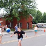 2012 Photo Gallery - Kids running on Main Street during Chatham Summerfest 2012
