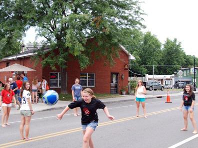 2012 Photo Gallery - Kids running on Main Street during Chatham Summerfest 2012
