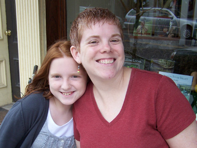 2010 photo gallery - Lorraine Bulson and her daughter are all smiles, standing outside The Chatham Bookstore,